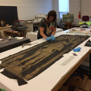 Amber Harwood, Georgian Bay Art Conservation, restoration of paper rubbing.